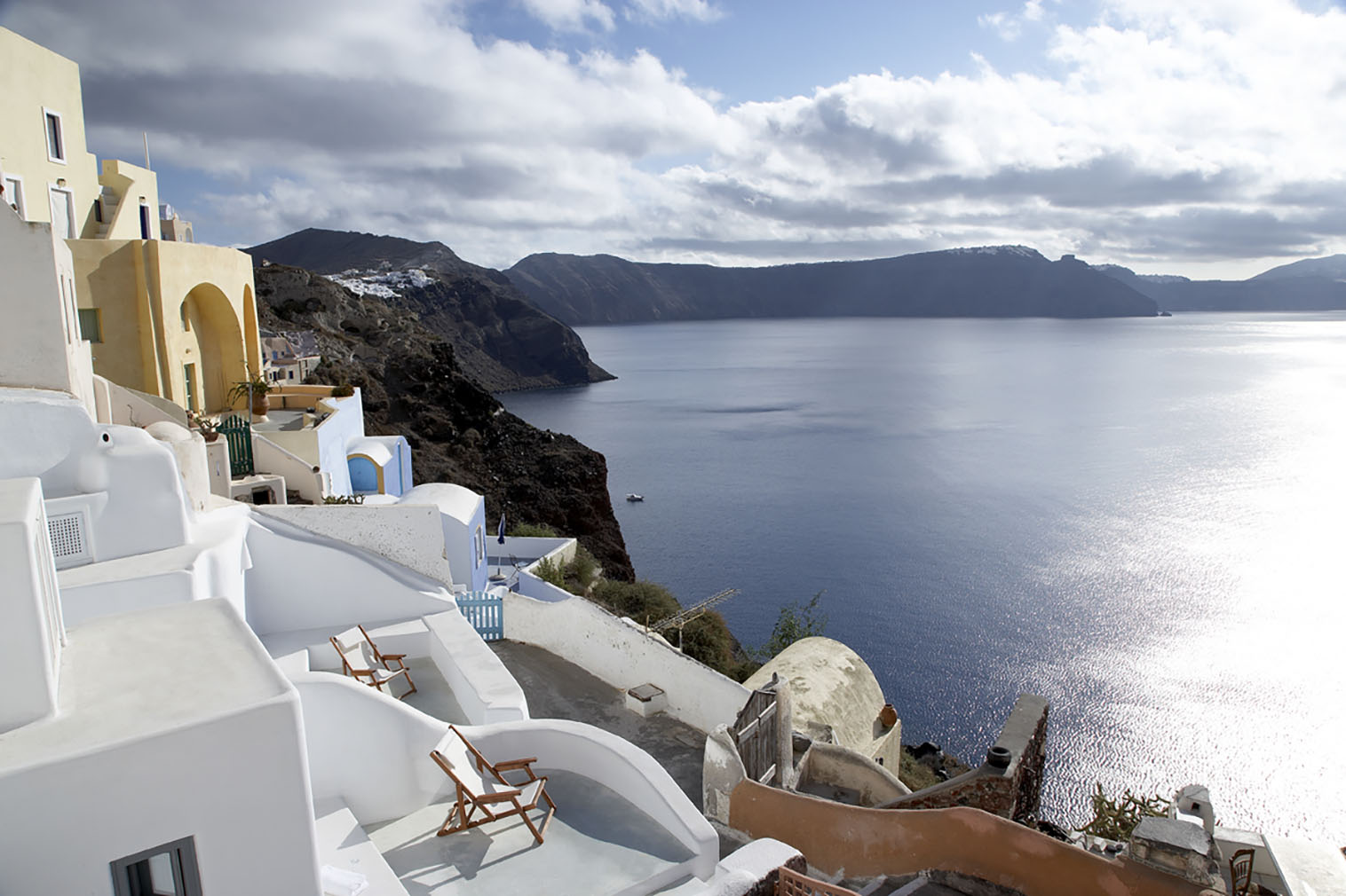 Glistening Cycladic volumes frame sea views at this cliffside Santorini vacation home – now for sale through Welcome Beyond.