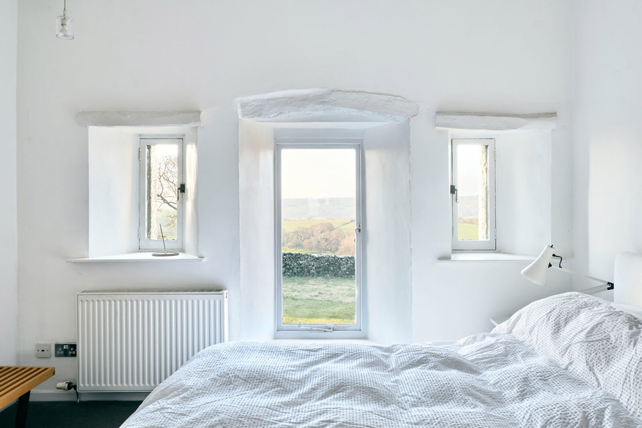 Bedrooms are a minimalist's dream, with whitewashed walls and ceilings and hardwood floors.