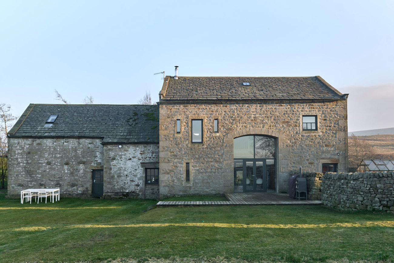 Sitting on the southerly edge of the Yorkshire Dales, on a private three-and-a-half-acre plot, Wildman's comprises two historic stone barns that have undergone a top-to-toe transformation by their owner.