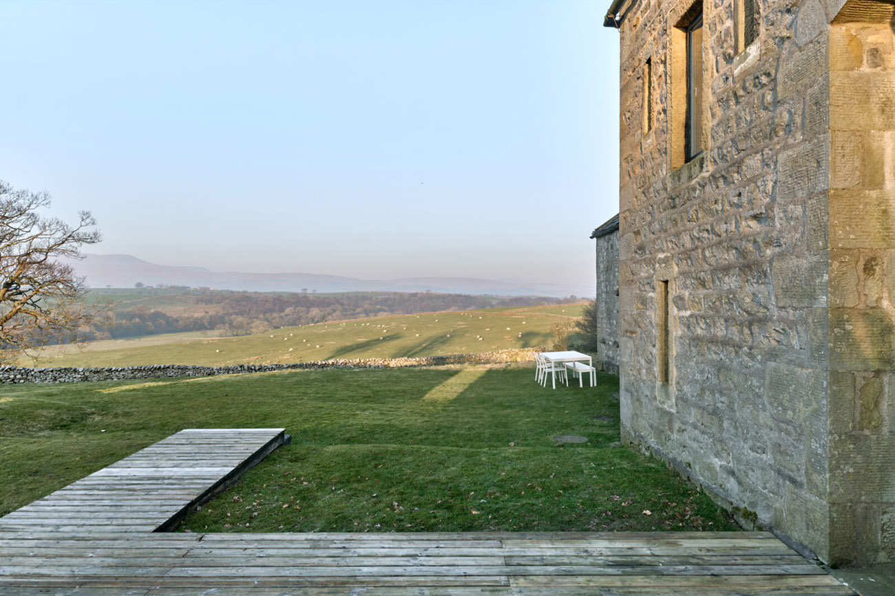 Large picture windows puncture the barn's historic gritstone facade, and skylights have been added on the simple slate roof to amplify light inside the five-bedroom country property.