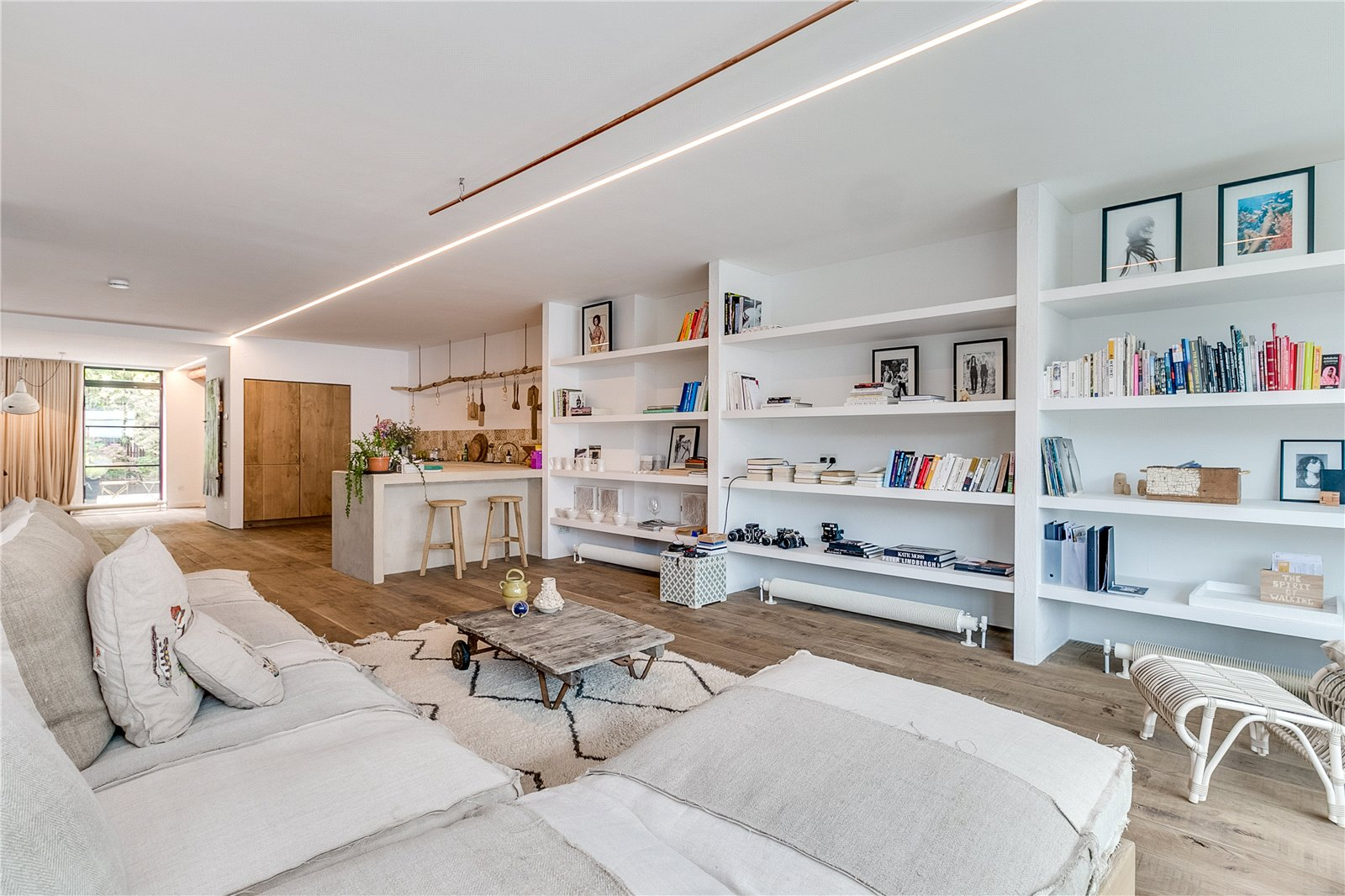 The apartment is inside the Piers Gough-designed Glass Building and is one of six homes accessed through Japanese water gardens, each with a private bridge to the front door.