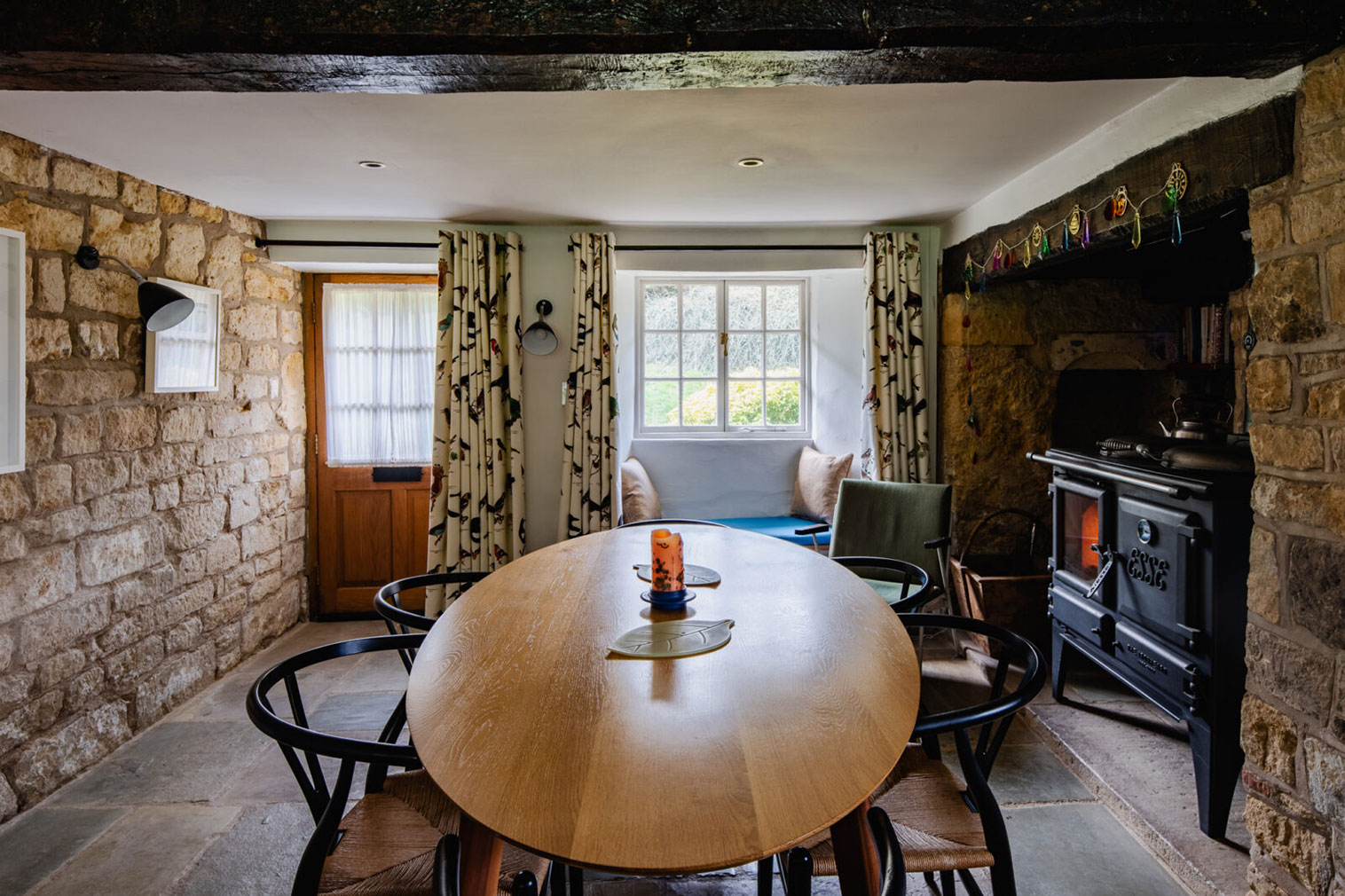 The ground floor has a separate dining room with flagstone floors, limestone walls and an inglenook fireplace