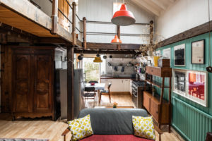 Far from minimalist, the rustic home is rich with textures, colour and eclectic furnishings