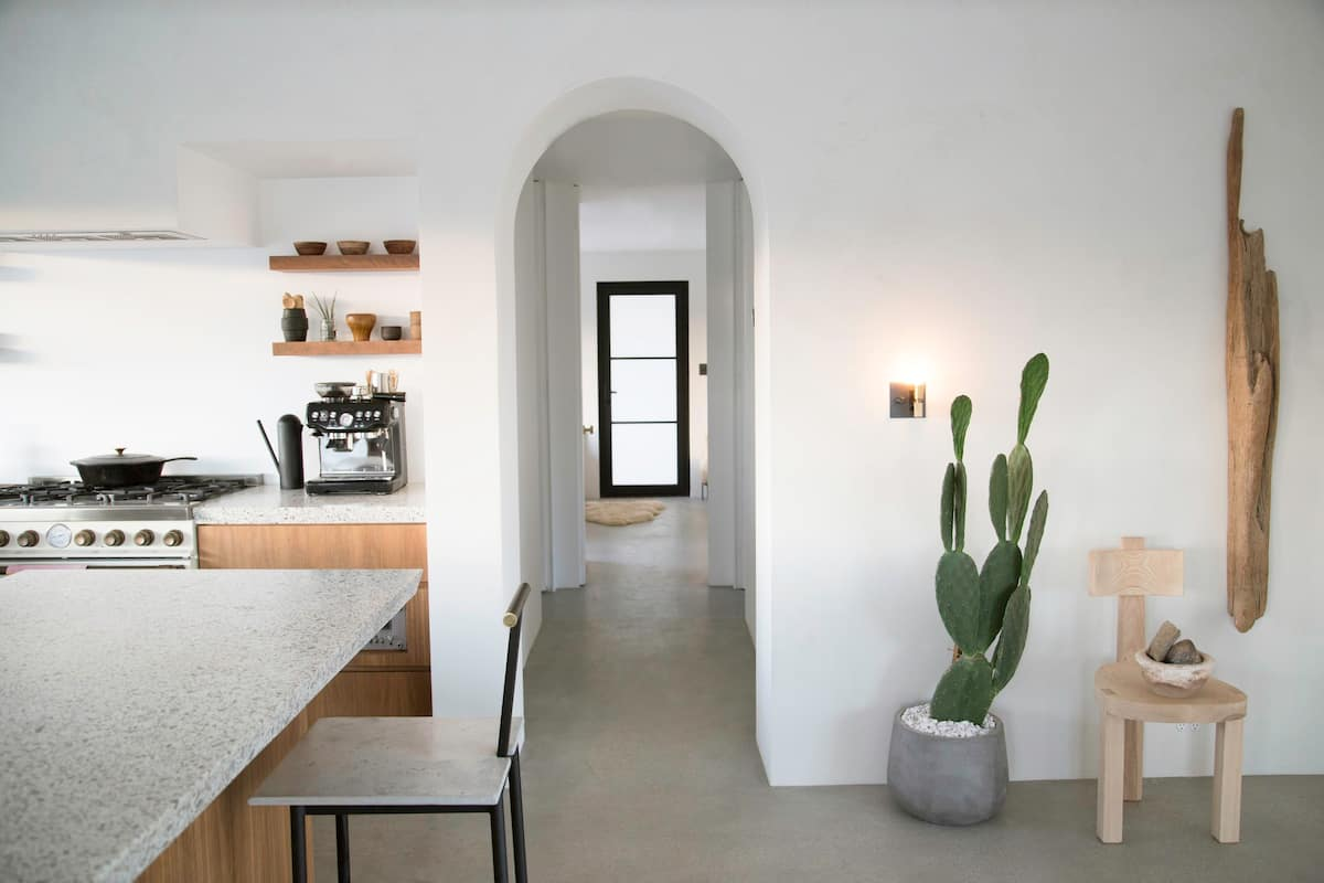 Archways lead sight-lines through the whitewashed home