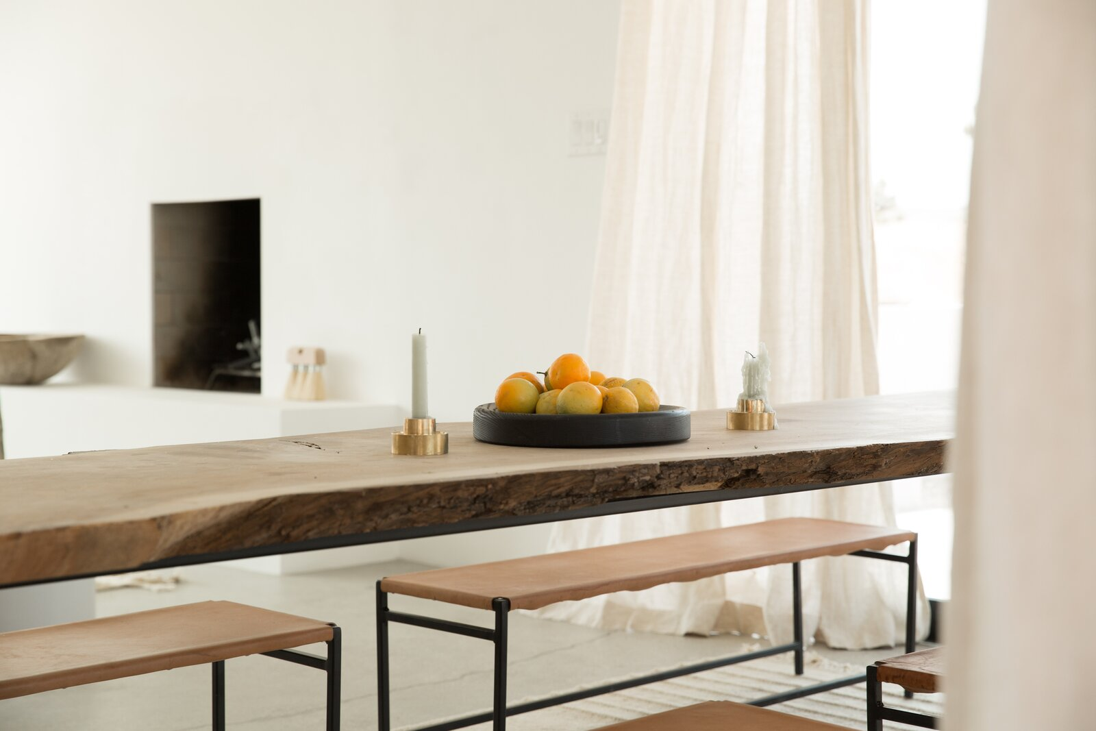 A table and bench by Jøna Maaryn inside the home