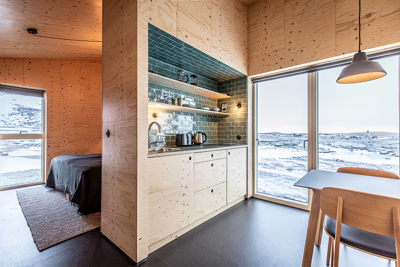 Studio Heima builds a charred cabin on an Icelandic lava field