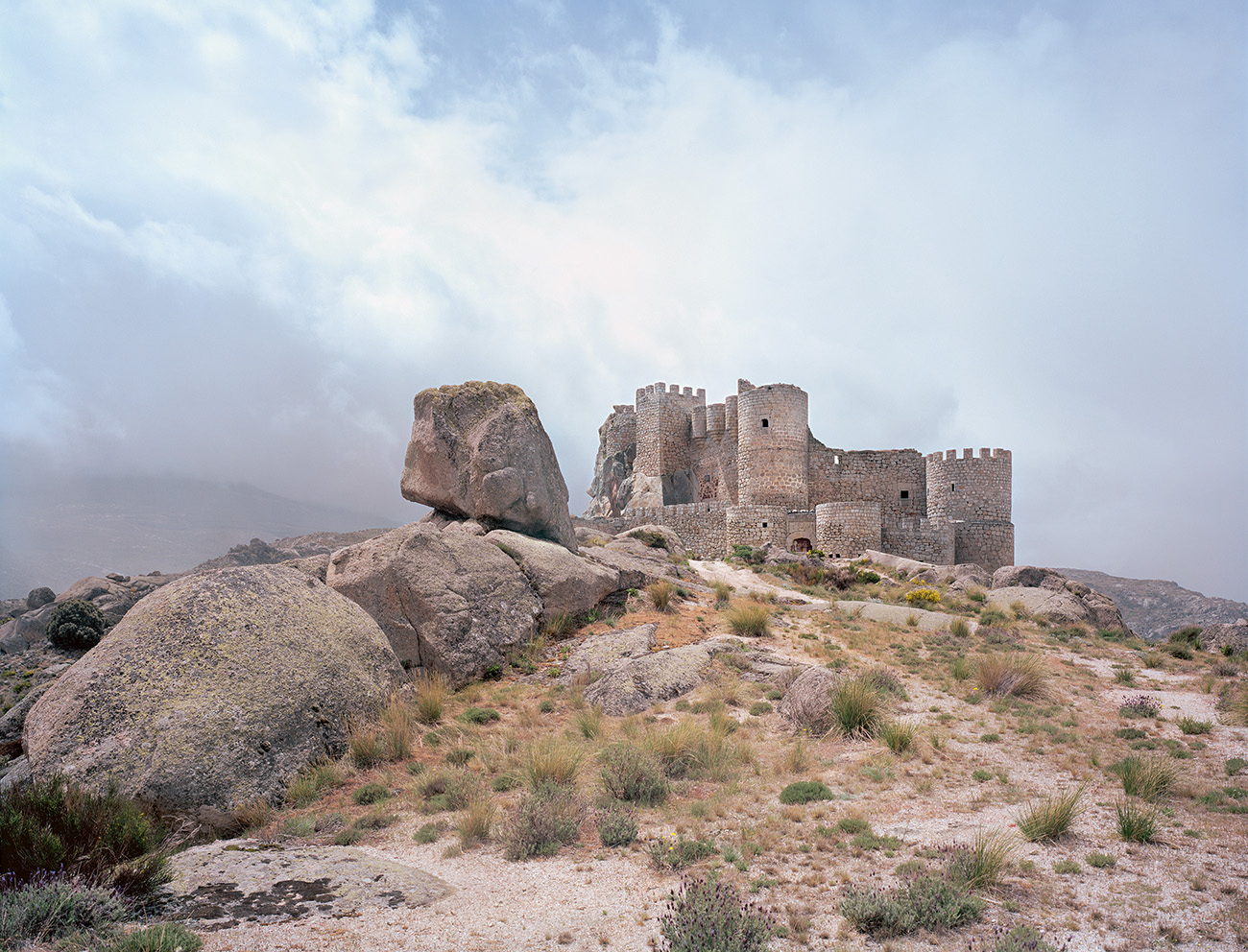 Manqueospese emerges from the rocky terrain of Ávila in Spain. The 11-15th century structure is constructed with native granite. Photography: Frédéric Chaubin/courtesy Taschen