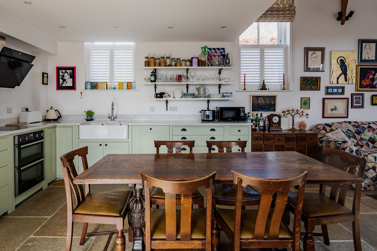 The kitchen is tucked beneath the mezzanine level, where the bedroom can be found