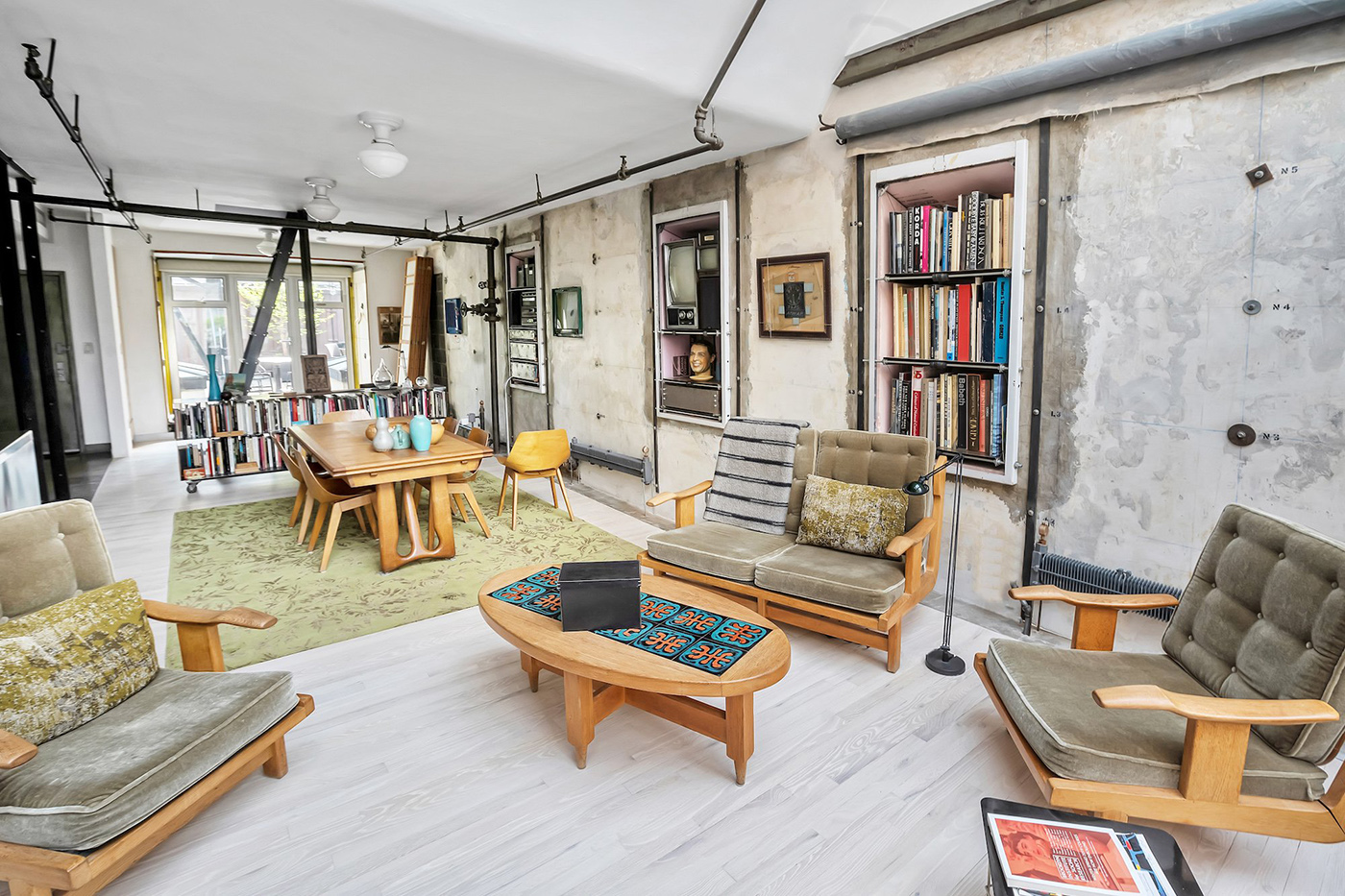 The apartment takes over the Manhattan building's former mechanics room