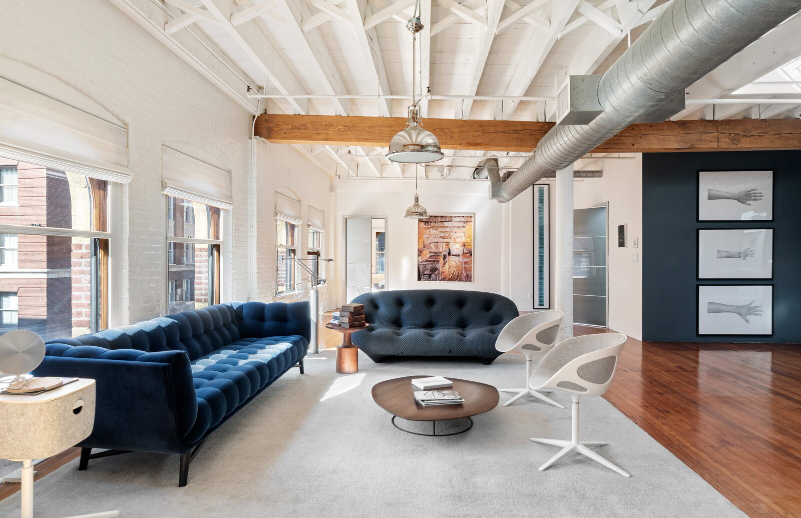 Loft-living gets a New England spin a this Boston penthouse apartment which takes over the entire top floor of a converted warehouse in the city's Leather District.