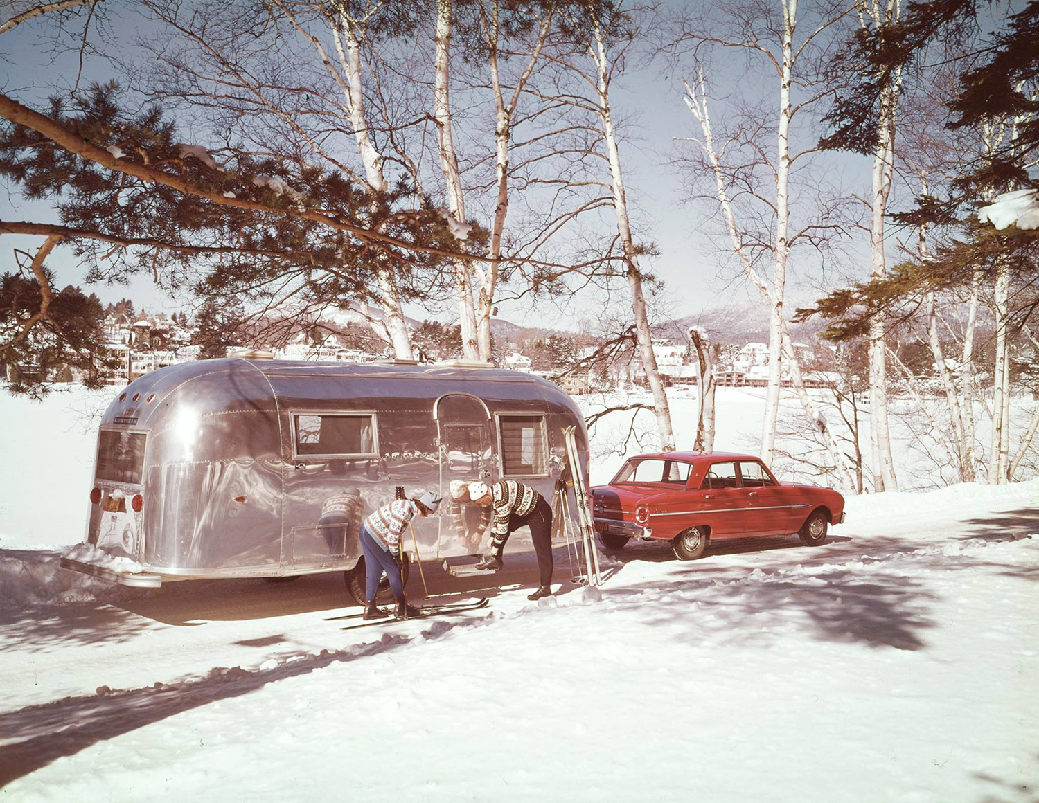 Archival footage of a 1950s airstream being towed through snow