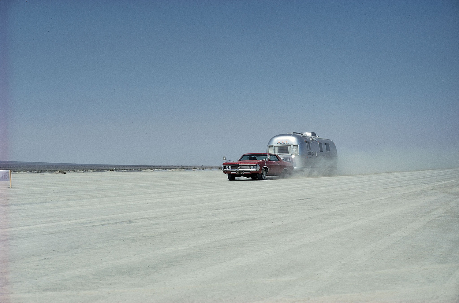 Vintage airstream being towed by a car