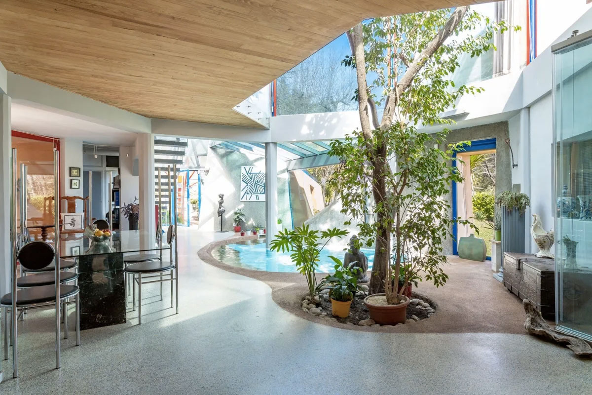 A lagoon atrium is at the heart of the Cote d'Azur property - on the market for under €1m in the hotspot