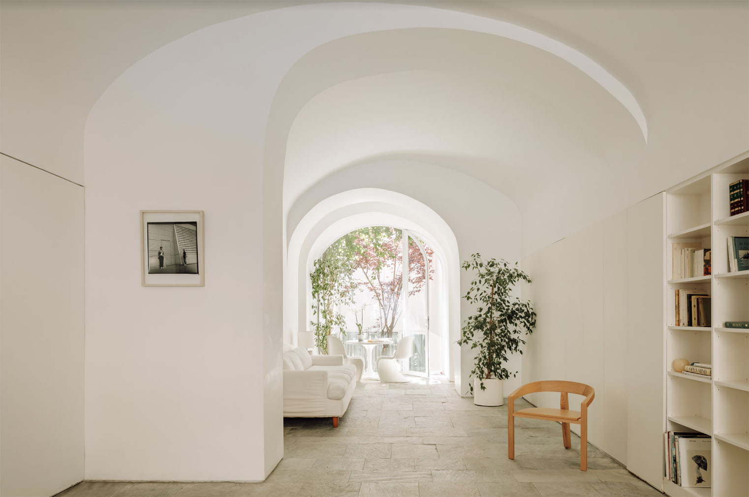 Interiors are minimalist, with focus placed on clean lines and skilled craftsmanship, while smooth arches and cool stone floors add drama to the architectural framing of its spaces.