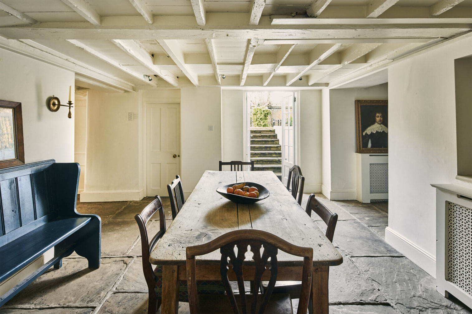 Painted rafters in the dining room showcase the low ceilings in this part of the home – previously the domain of domestic servants