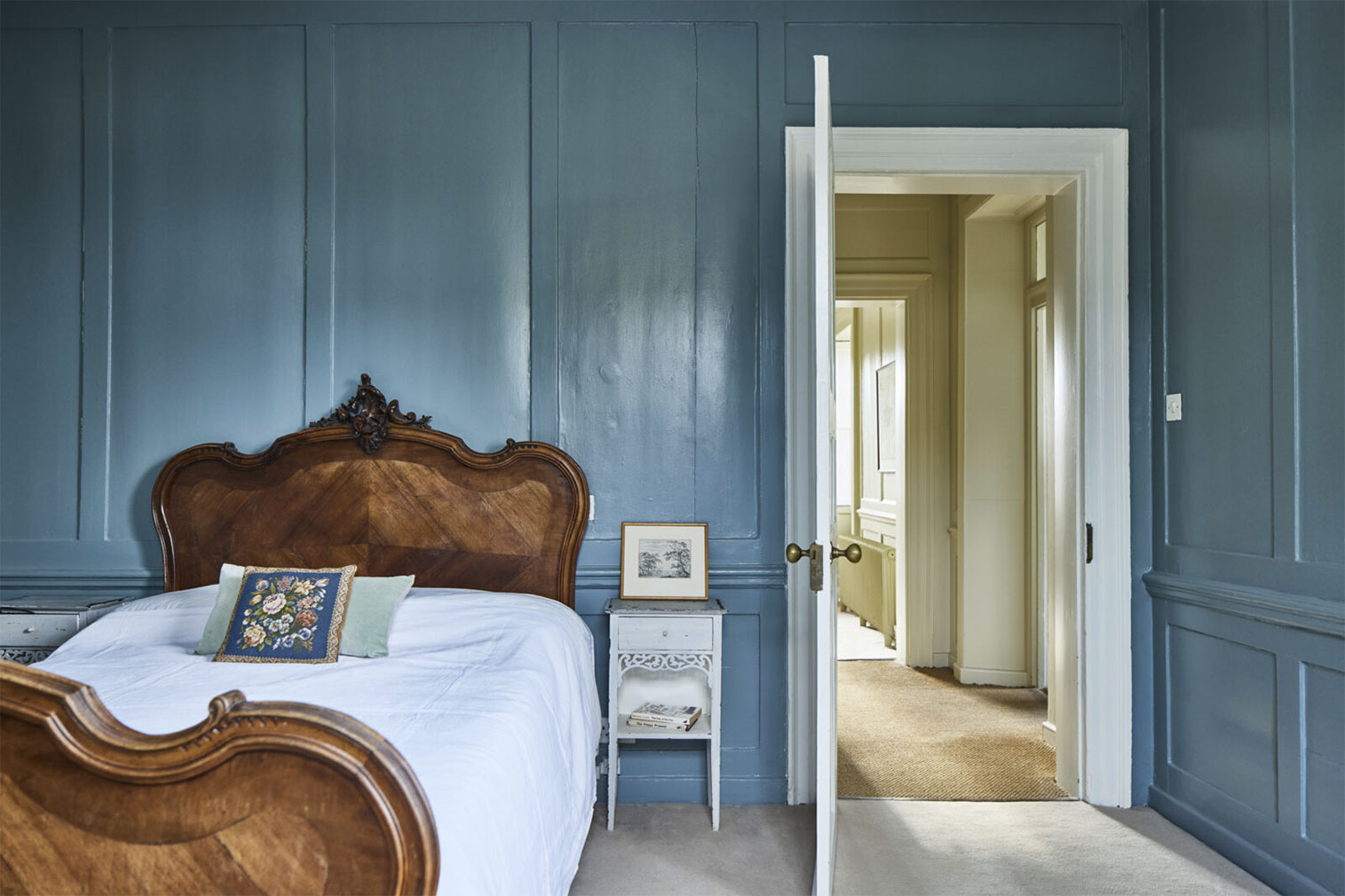 Painted panelling and period furnishings recall the Regency era