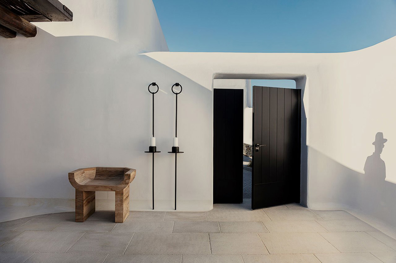 Wooden furniture, stone, iron and stucco create a naturally-inspired and modern Cycladic aesthetic