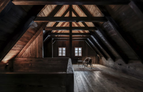 Mezi Lukami is a Czech mountain refuge with minimalist, moody interiors
