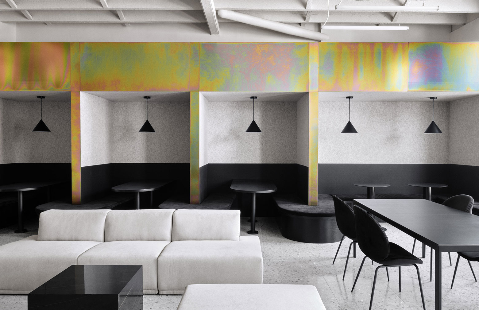 Zinc metal cladding across the upper parts of the space casts an iridescent spectrum