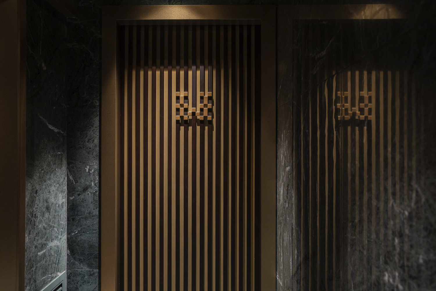 Dark green marble is used in the bathrooms and reception area