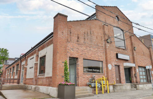 Toronto live/work building is for sale with an indoor rock climbing gym inside