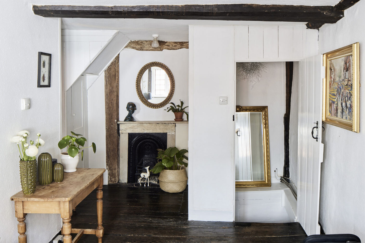 A landing with period fireplace and access from the original timber staircase