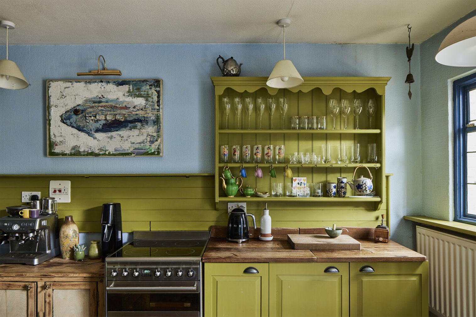The kitchen features bespoke cabinetry