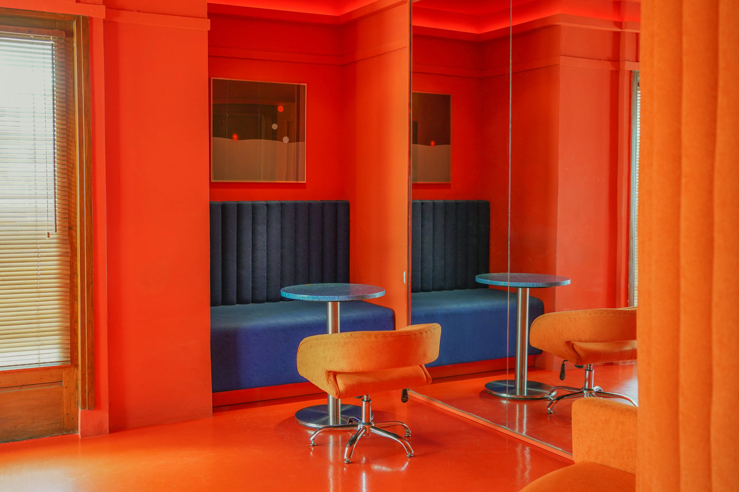 Banquette seating offers a place to pore over purchases and sip a cocktail at Peels Records' sound bar