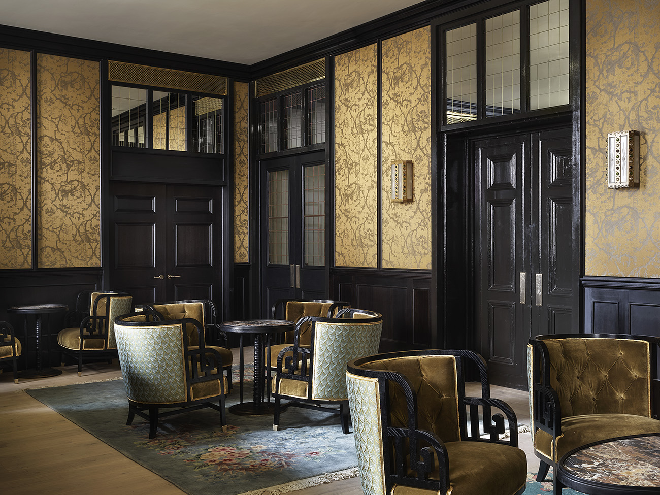 Wallpaper is used heavily across Roman and William's interiors, which pick up cues from the Covent Garden location and its floral offerings