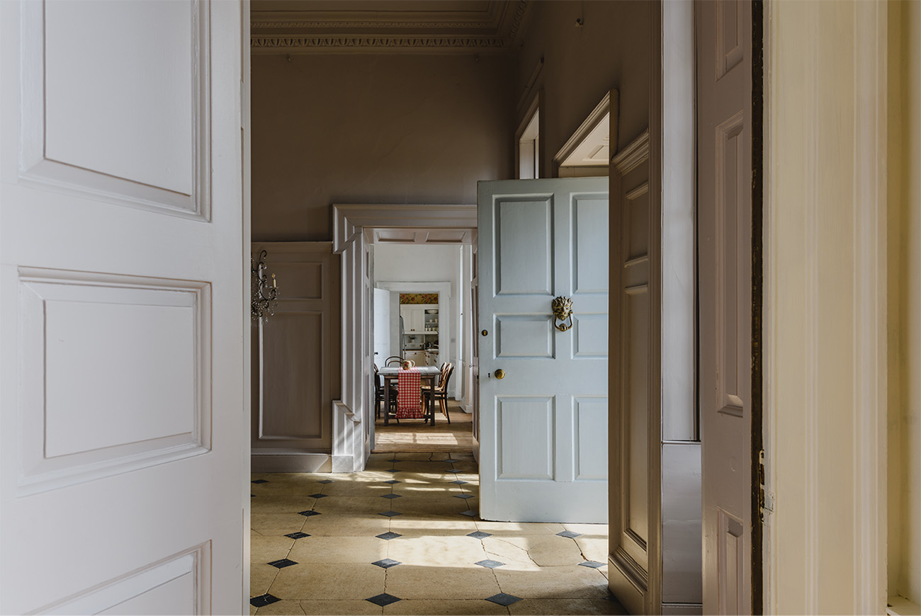 Views through the ground floor of the property from the reception room through to the kitchen at the end