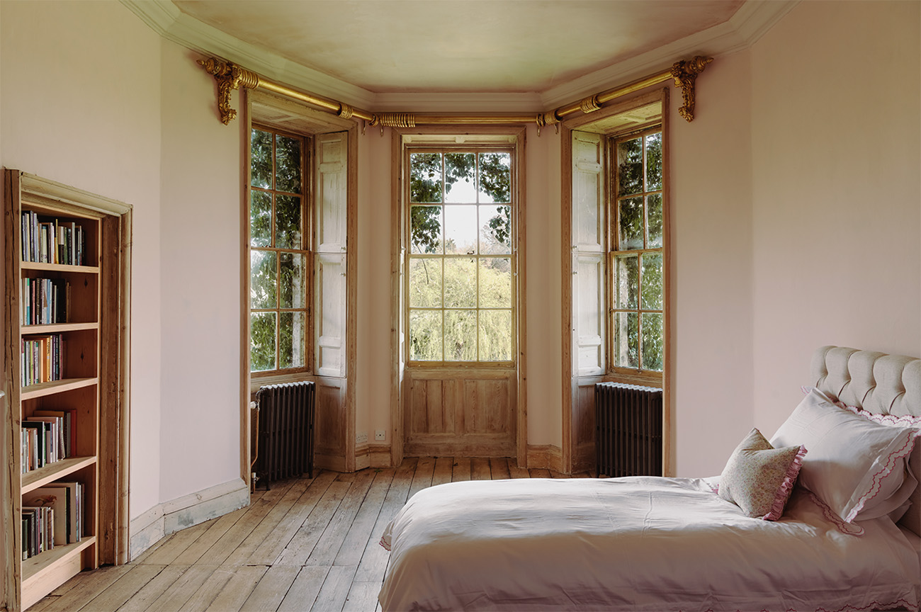One of seven bedrooms inside the main house