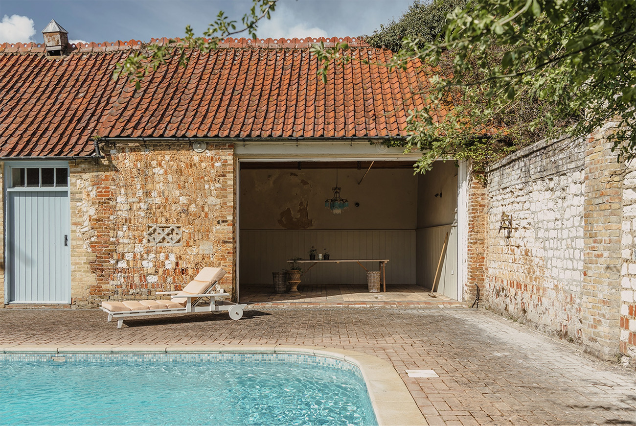 One of the converted outbuildings, which is set around a courtyard pool