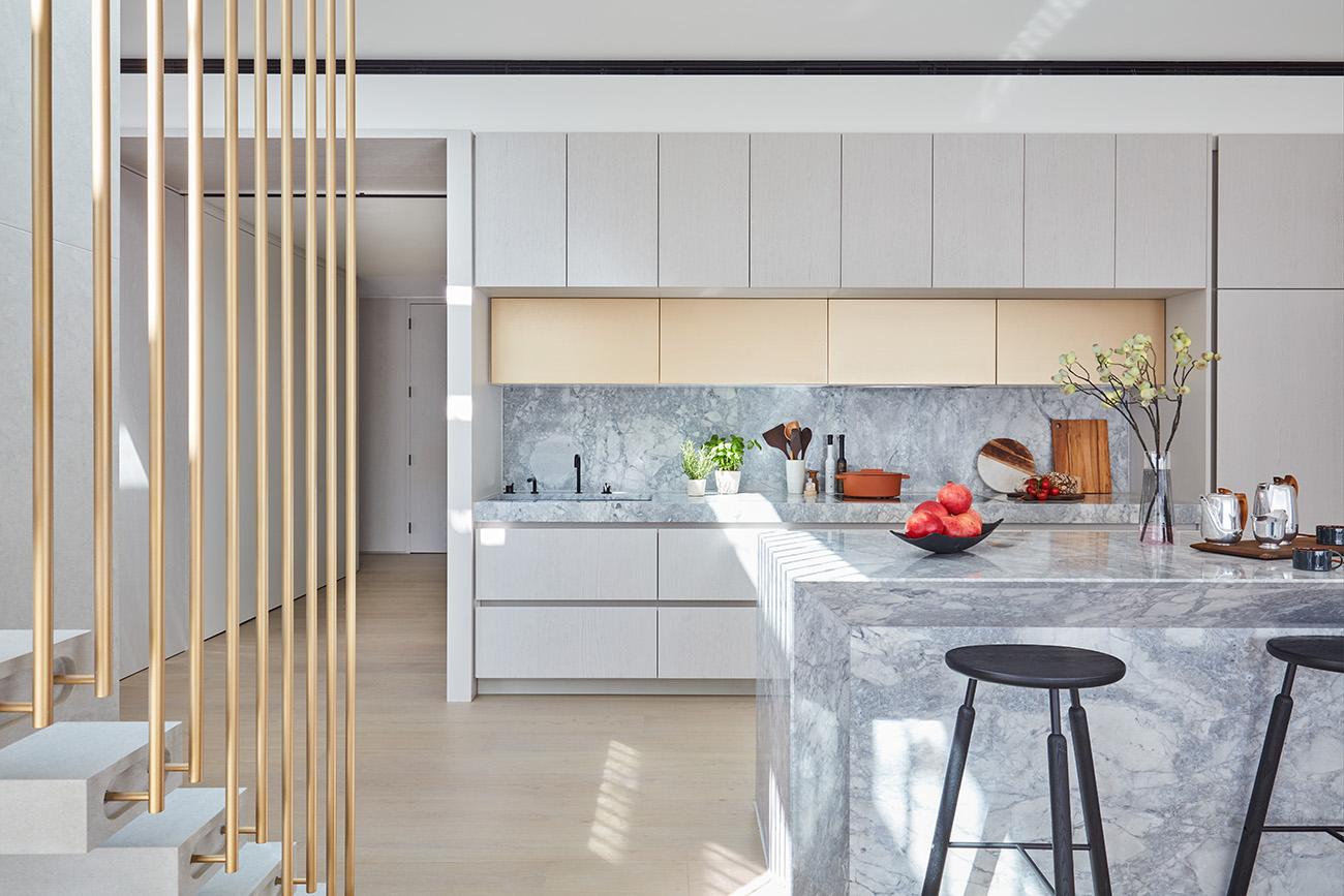 Stone plays a huge role in the kitchen, continuing the nature-inspired material palette