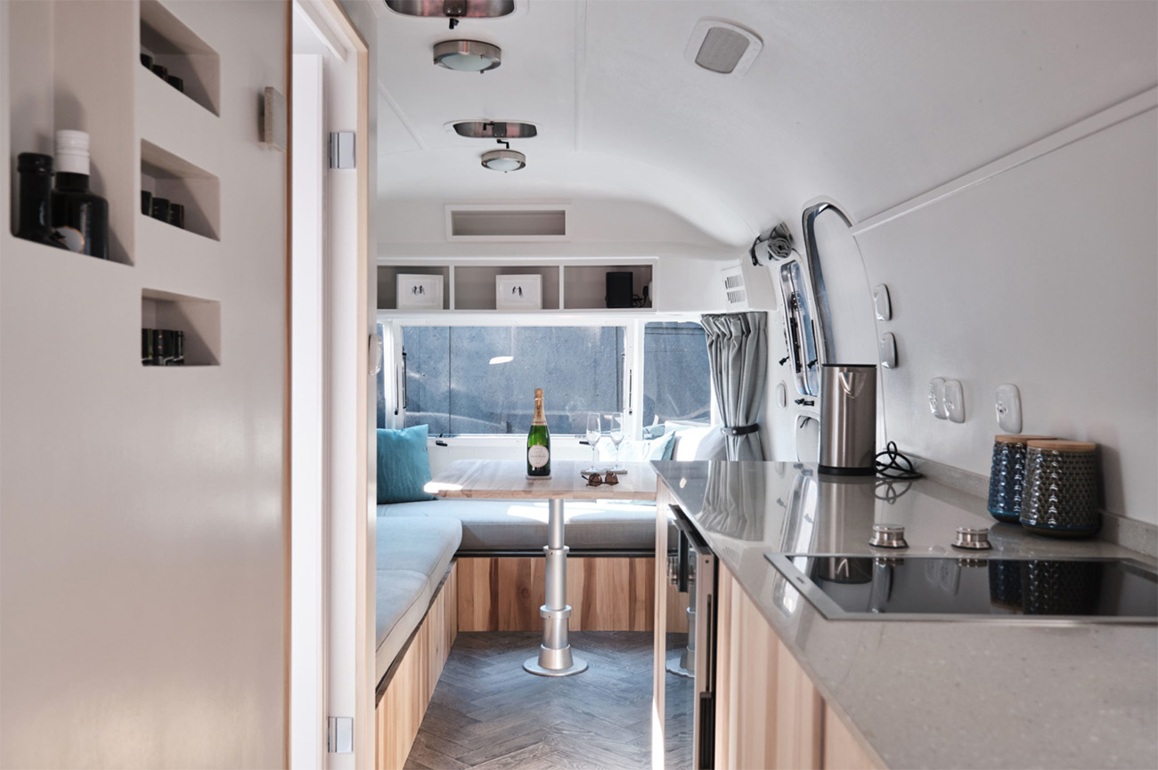 Kitchen cabinetry is made with poplar timber and terrazzo tops