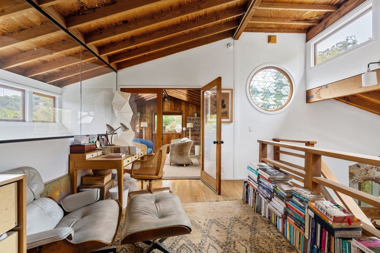 The landing houses a reading nook with clerestory windows