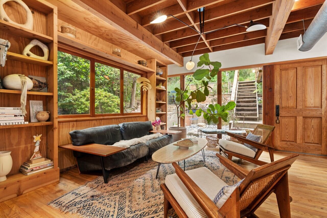 Interiors have a treehouse bent thanks to excessive timber and exposed rafters