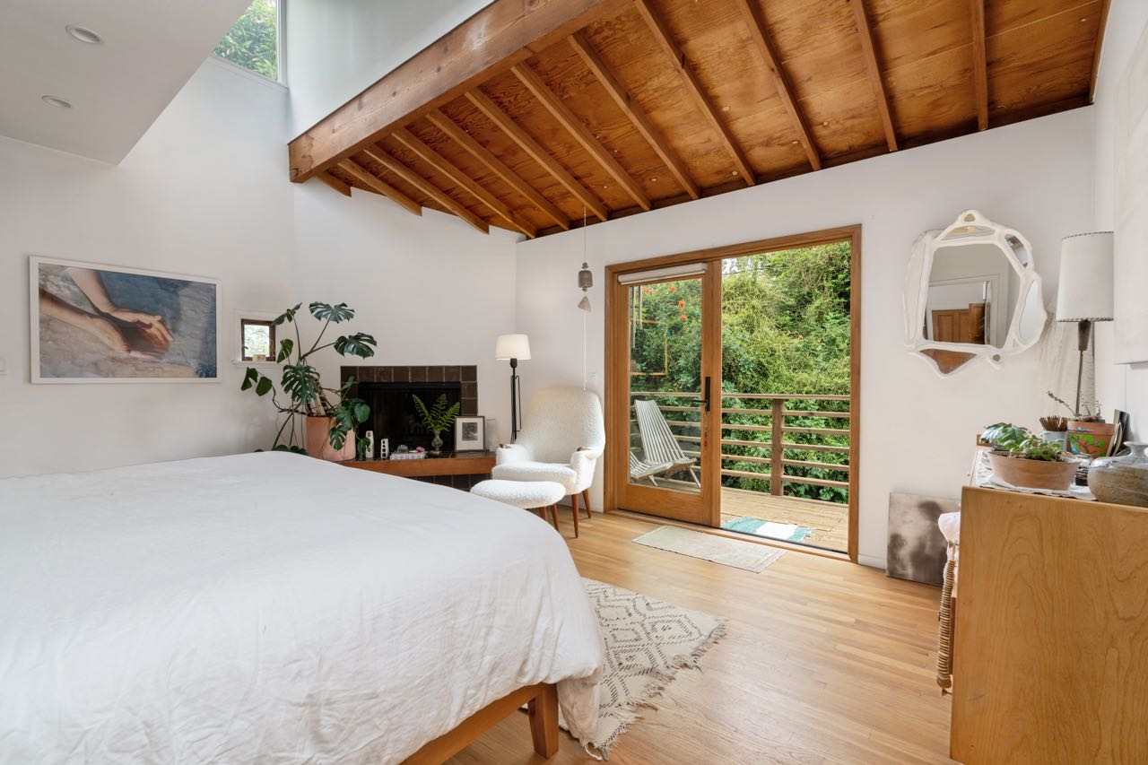 The bedroom has skylight windows as well as french doors that open onto the balcony