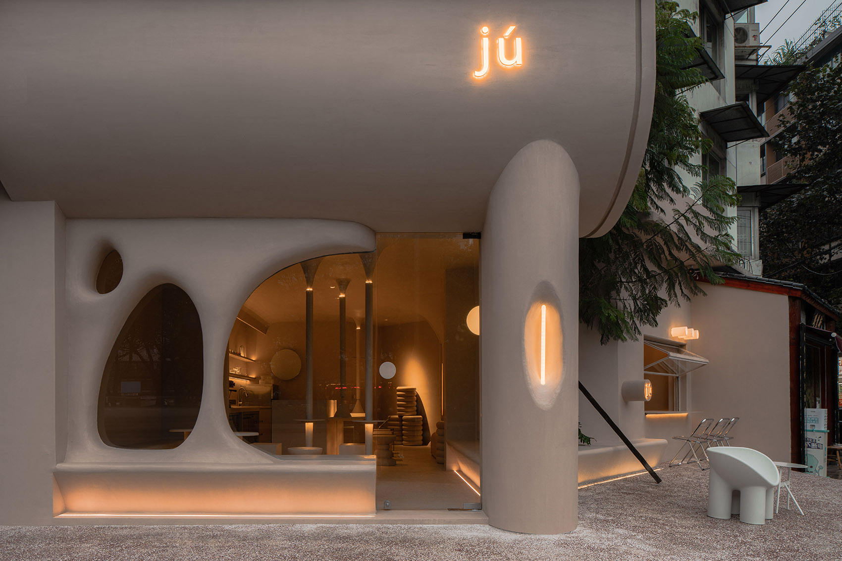 Oval window openings and pillars evoke an ancient troglodyte dwelling