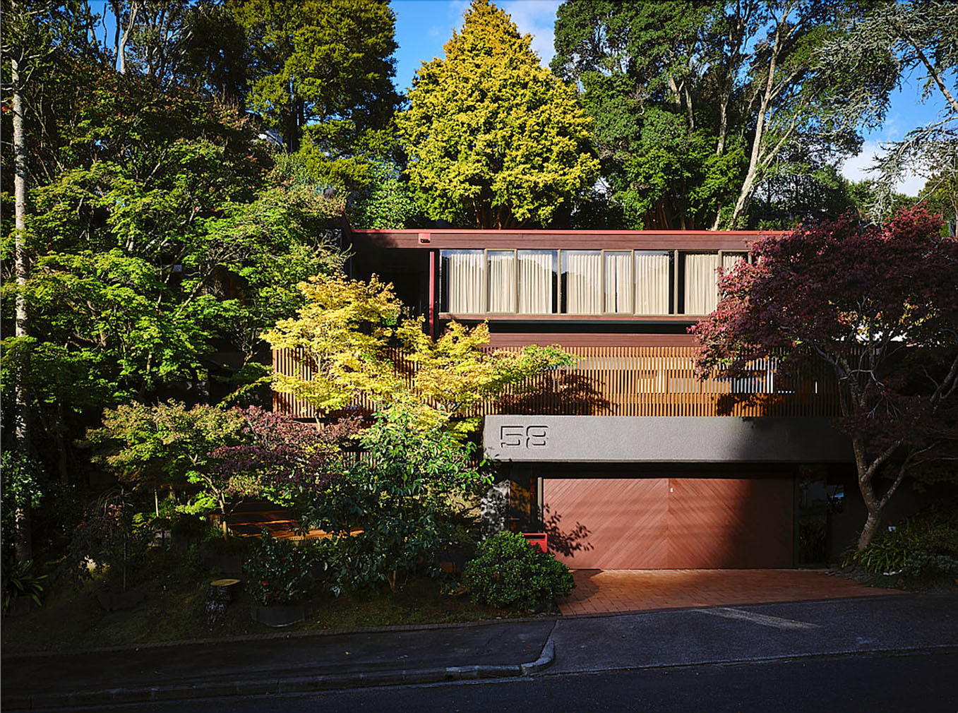The 1970s home has serious curb appeal thanks to its stepped silhouette and terraced gardens