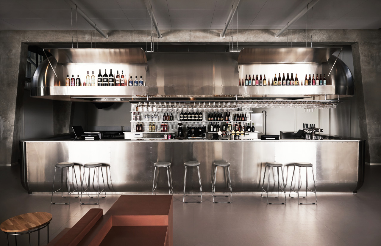 Stainless steel rules at the communal bar which adds a sophisticated industrial flare to the hostel