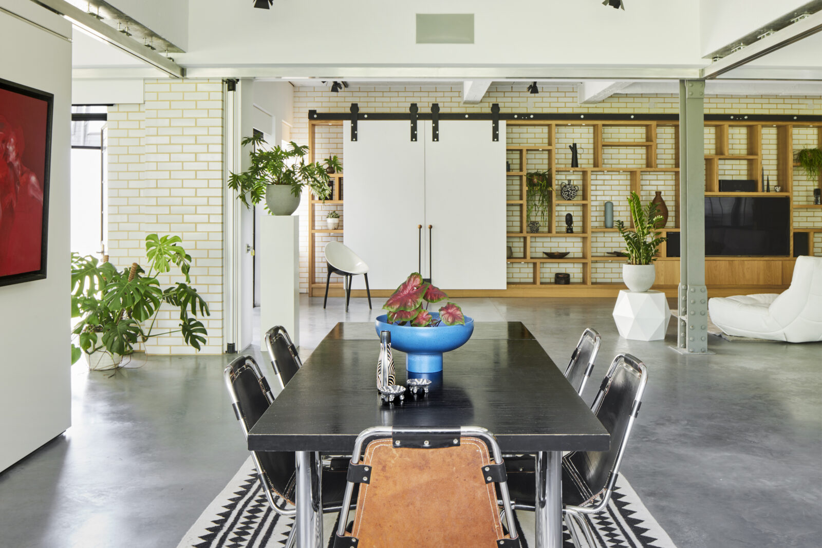 Polished concrete floors run across the apartment which retains an open and adaptable floorplan courtesy of moveable walls