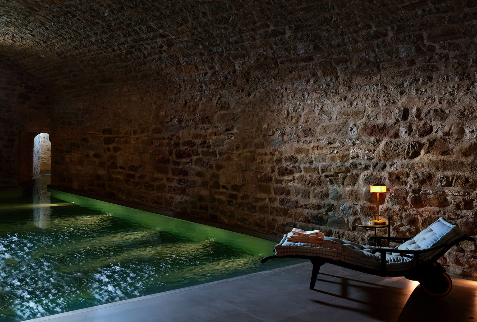 As well as an outdoor pool, set into the hotel lawn, the castle's ancient wine cellars are now a Roman bath-inspired spa