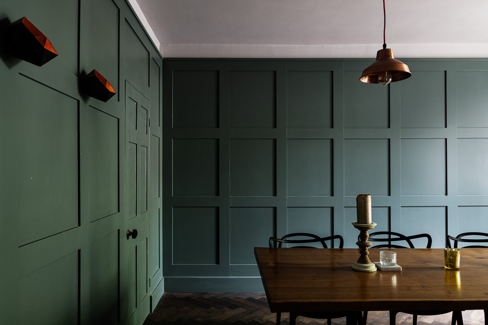 Teal panelling in the dining room