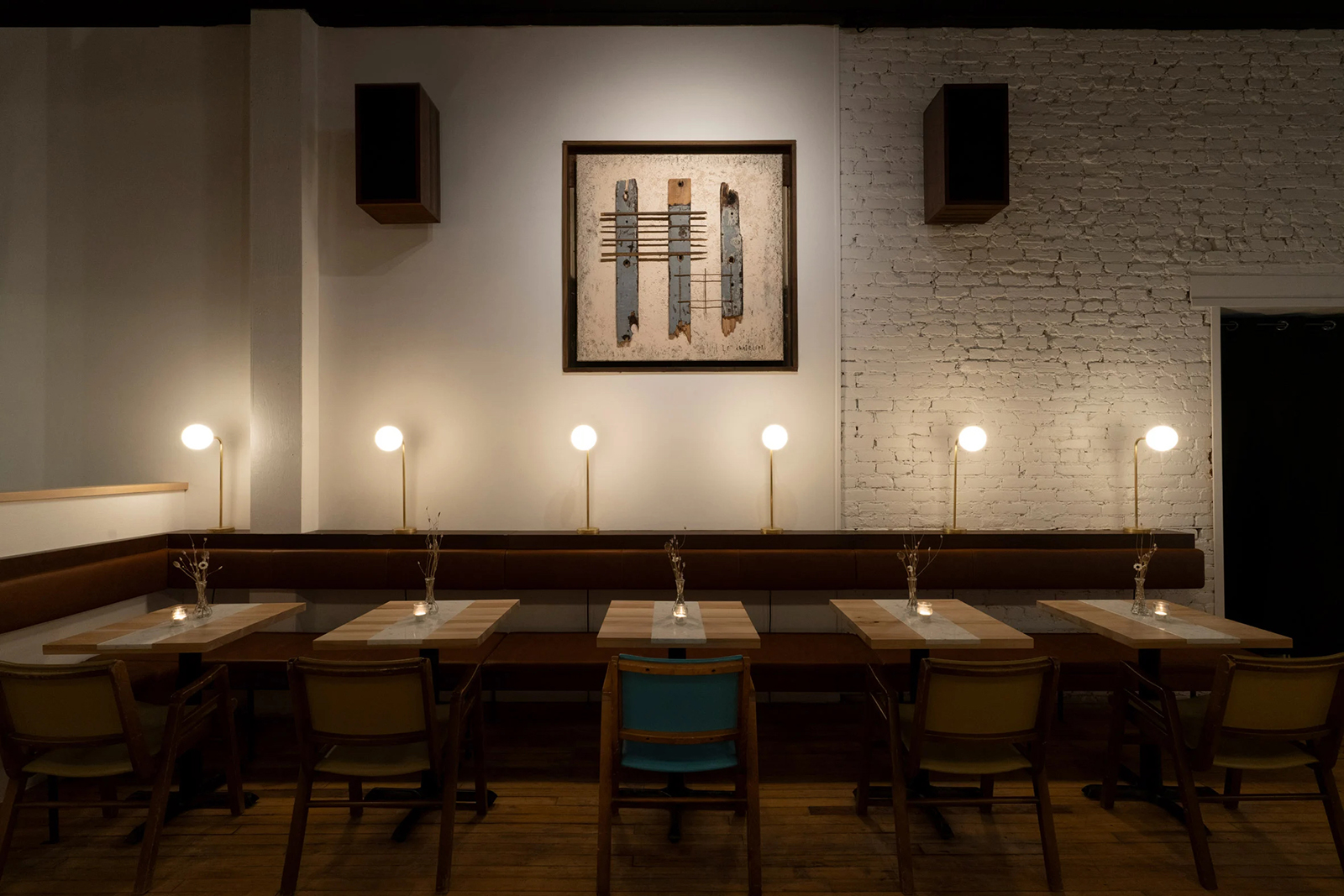 Artworks were created for the space by a local designer, using reclaimed materials discarded during the refurbishment