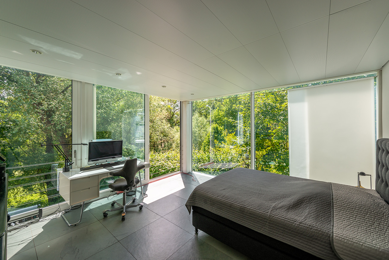 Almost every room has views across the tree canopy and mature gardens