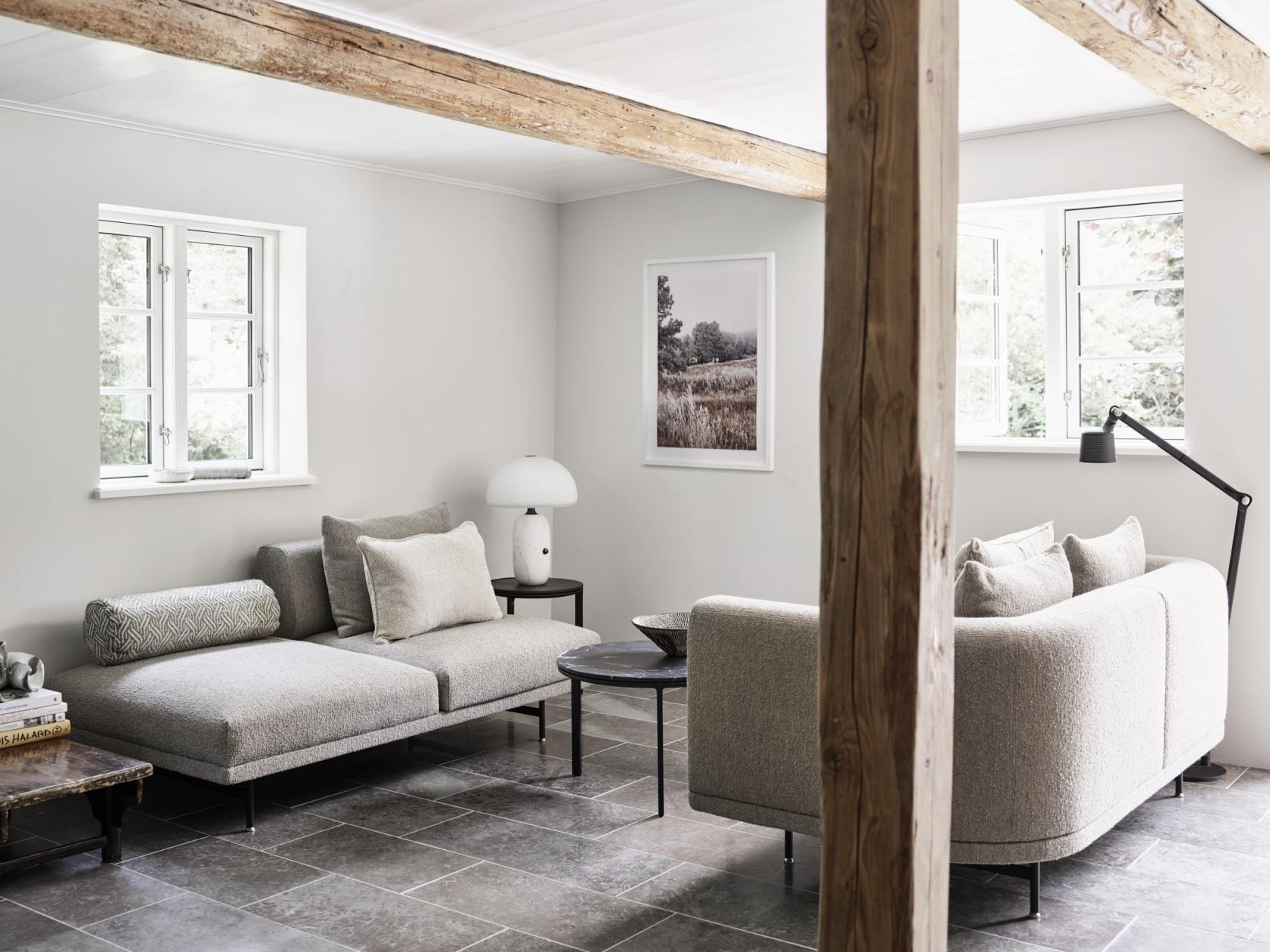 Sofas by Vipp nestle in the living room