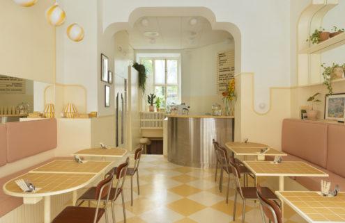Lemon drop interiors bring a Havana vibe to this Stockholm breakfast spot
