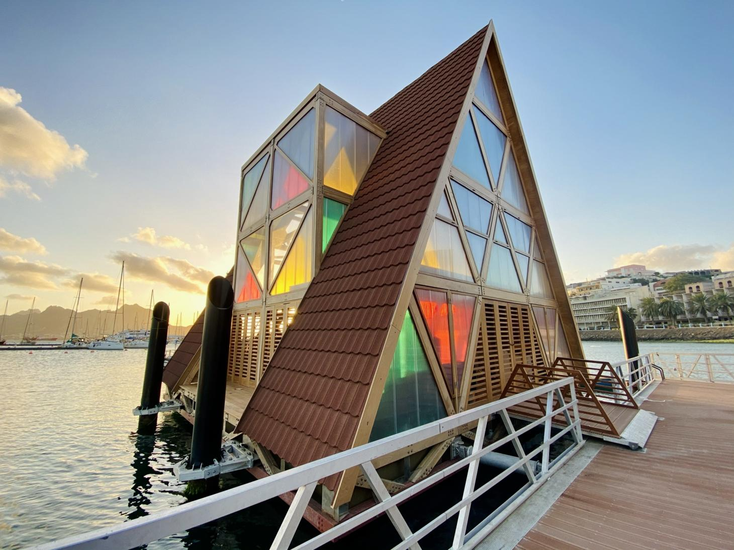 The triangular facade features brightly coloured panels of stained glass