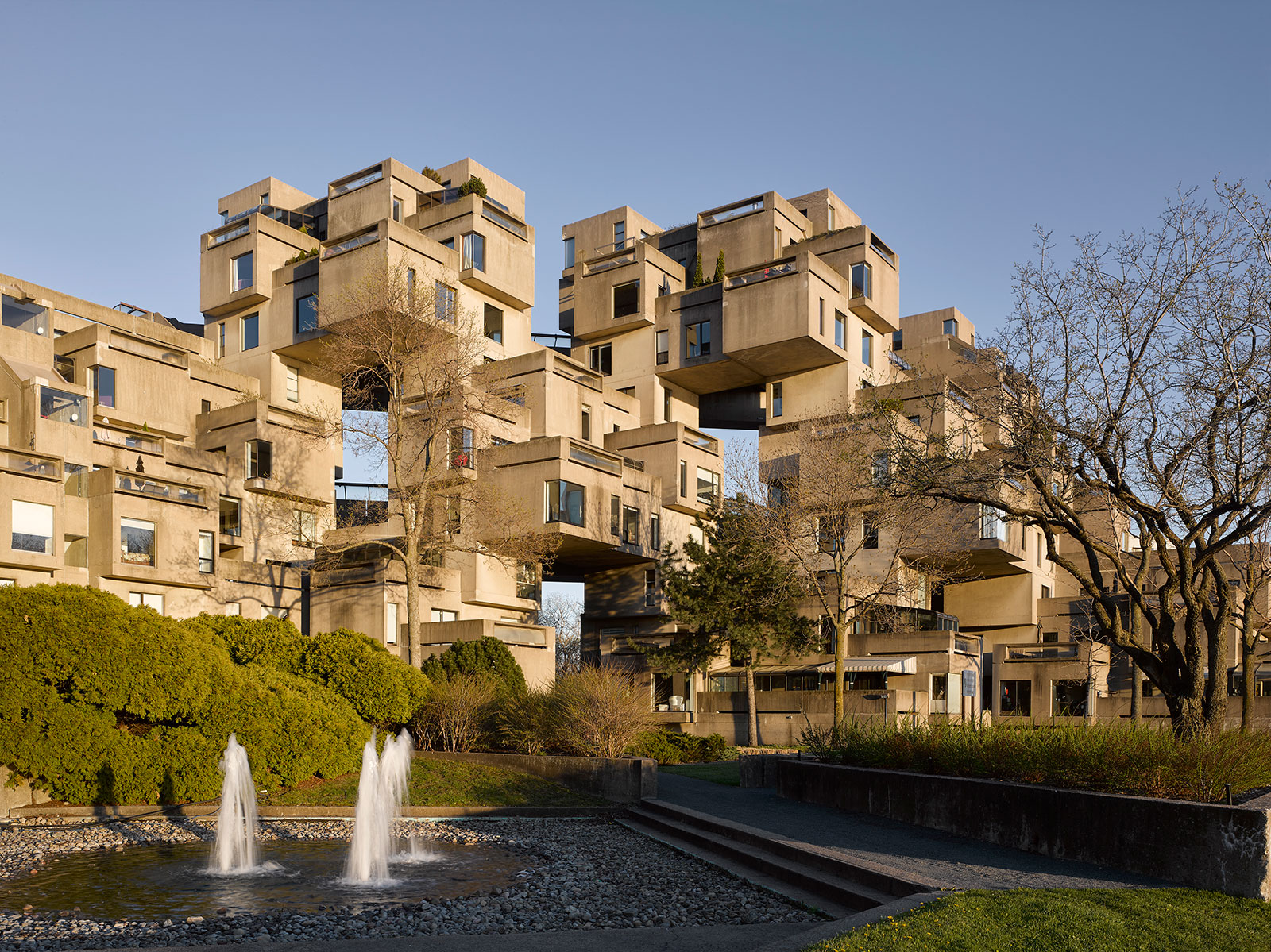 The futuristic form of Habitat 67 comprises stacked concrete cubes – each dwelling has its own outdoor space and unique view