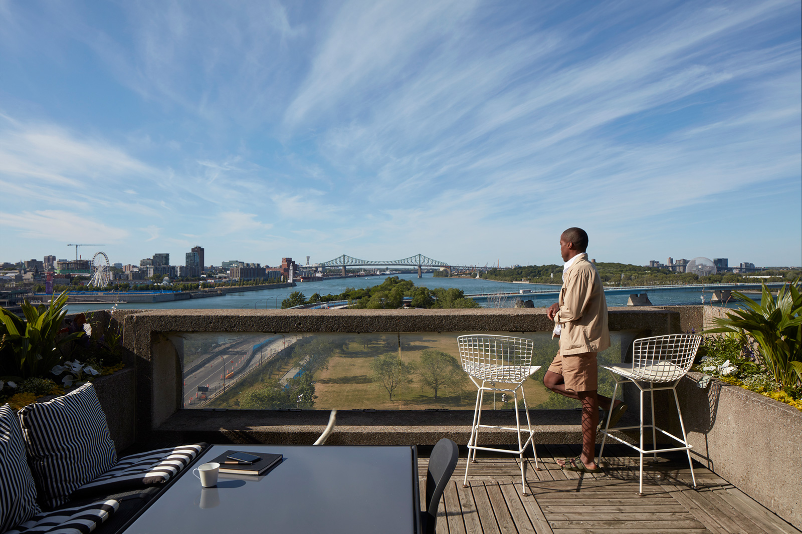 Byron looks out across the St Lawrence River from his garden terrace